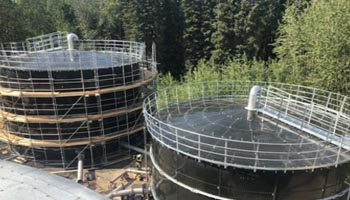 two portable water storage tanks